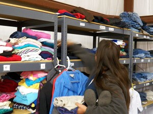 Participant accesses HMHI clothing donations